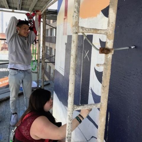 Students Create Vibrant 8-Story Mural on Cova Hotel