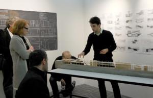 Architecture Student Presenting Scale Model