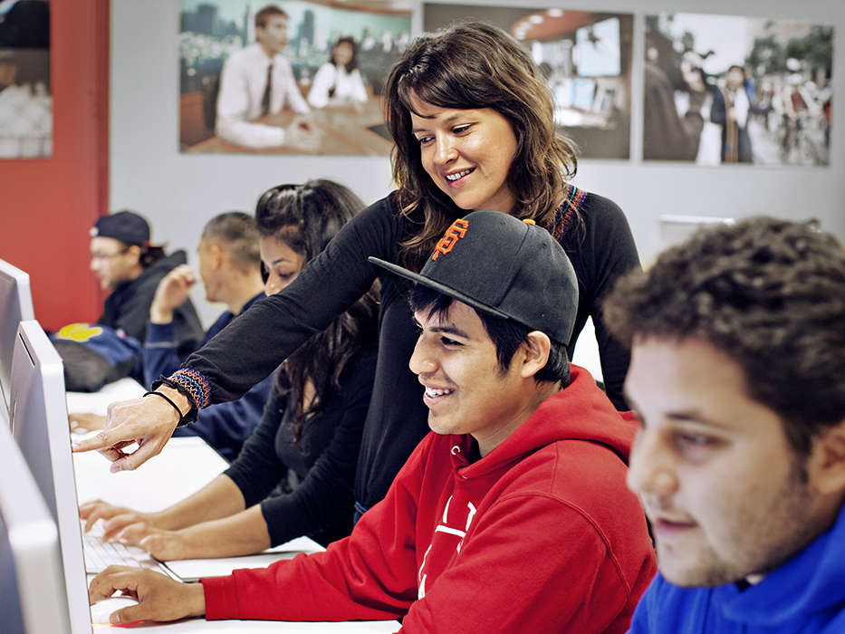 Student and Teacher Smiling in Front of Computer