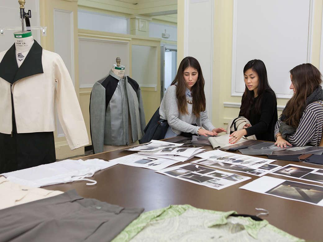 Girls Looking at Fashion Photos