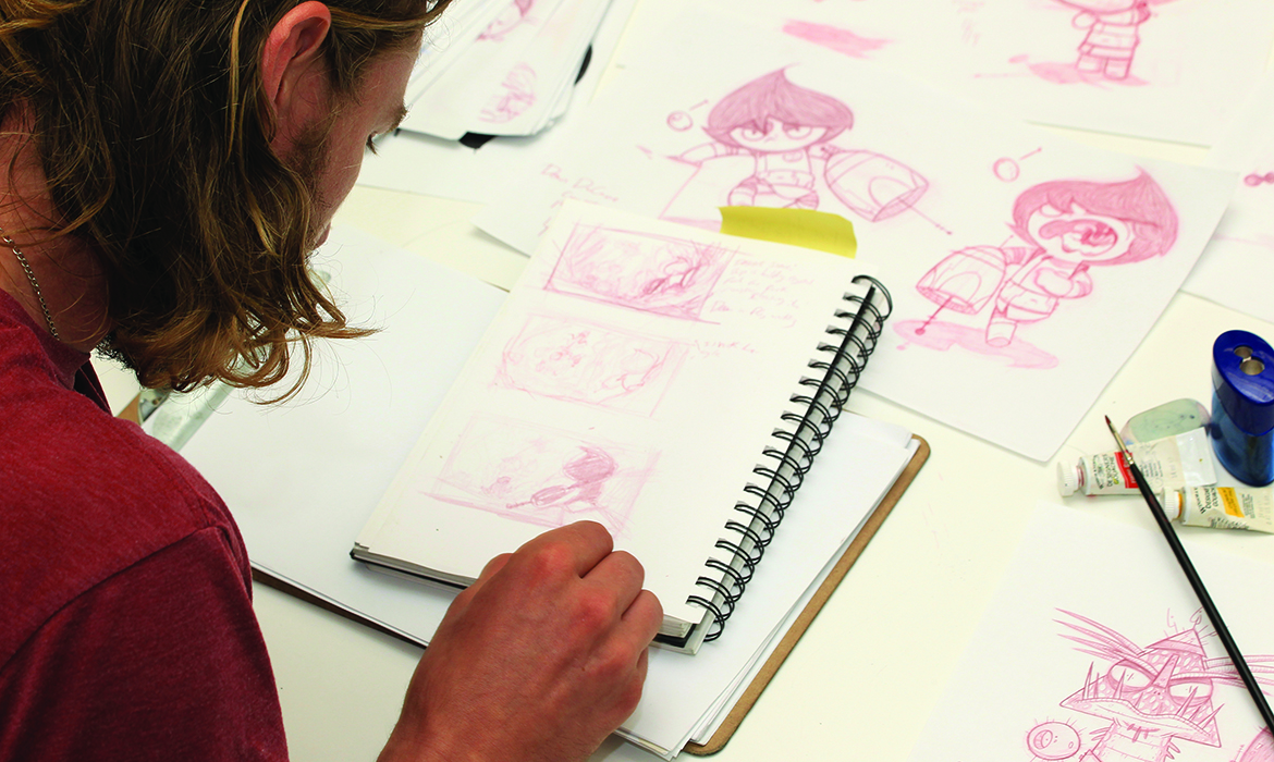 student drawing storyboard on sketchpad