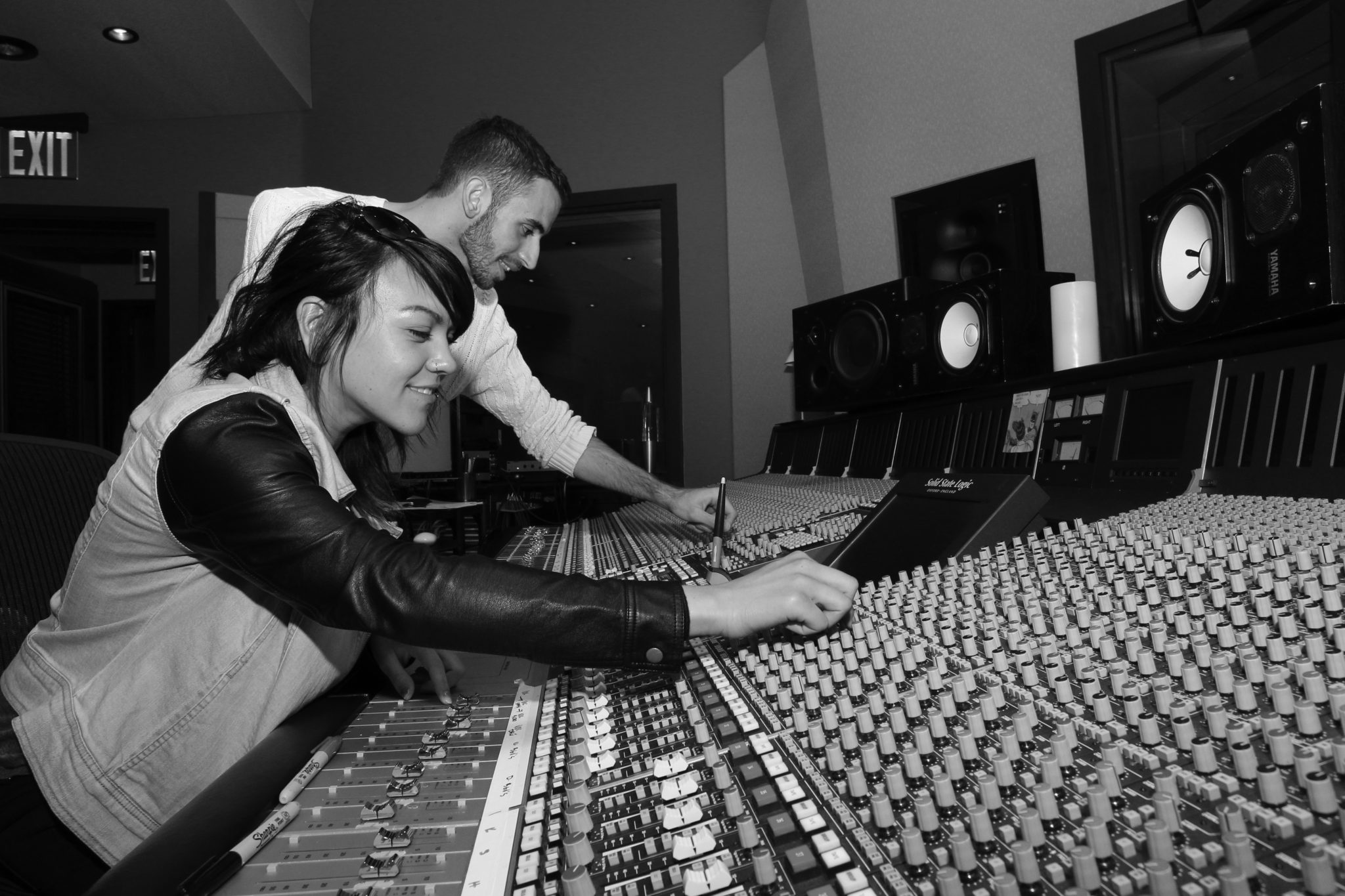 Students inside music production booth