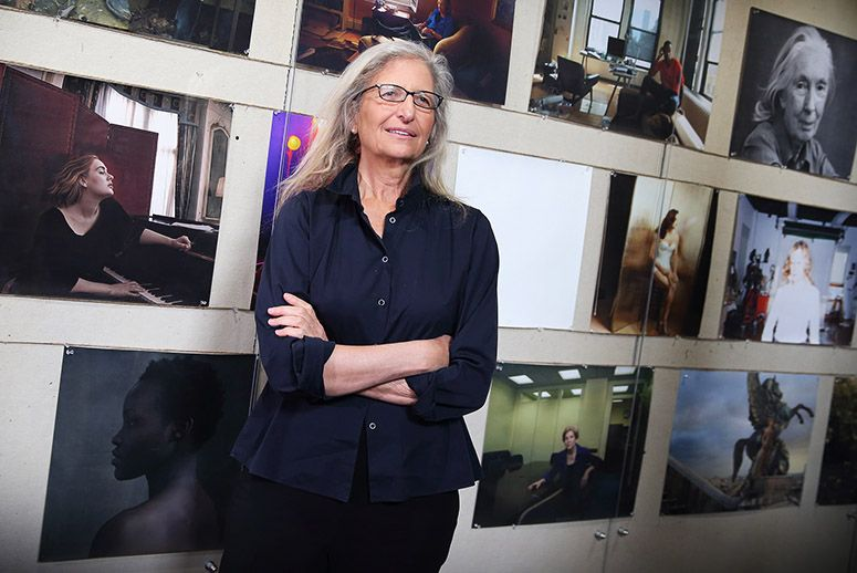 Annie Leibovitz poses in front of her works