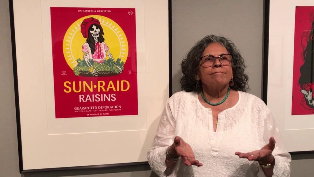 Ester Hernandez with her Sunraid artwork