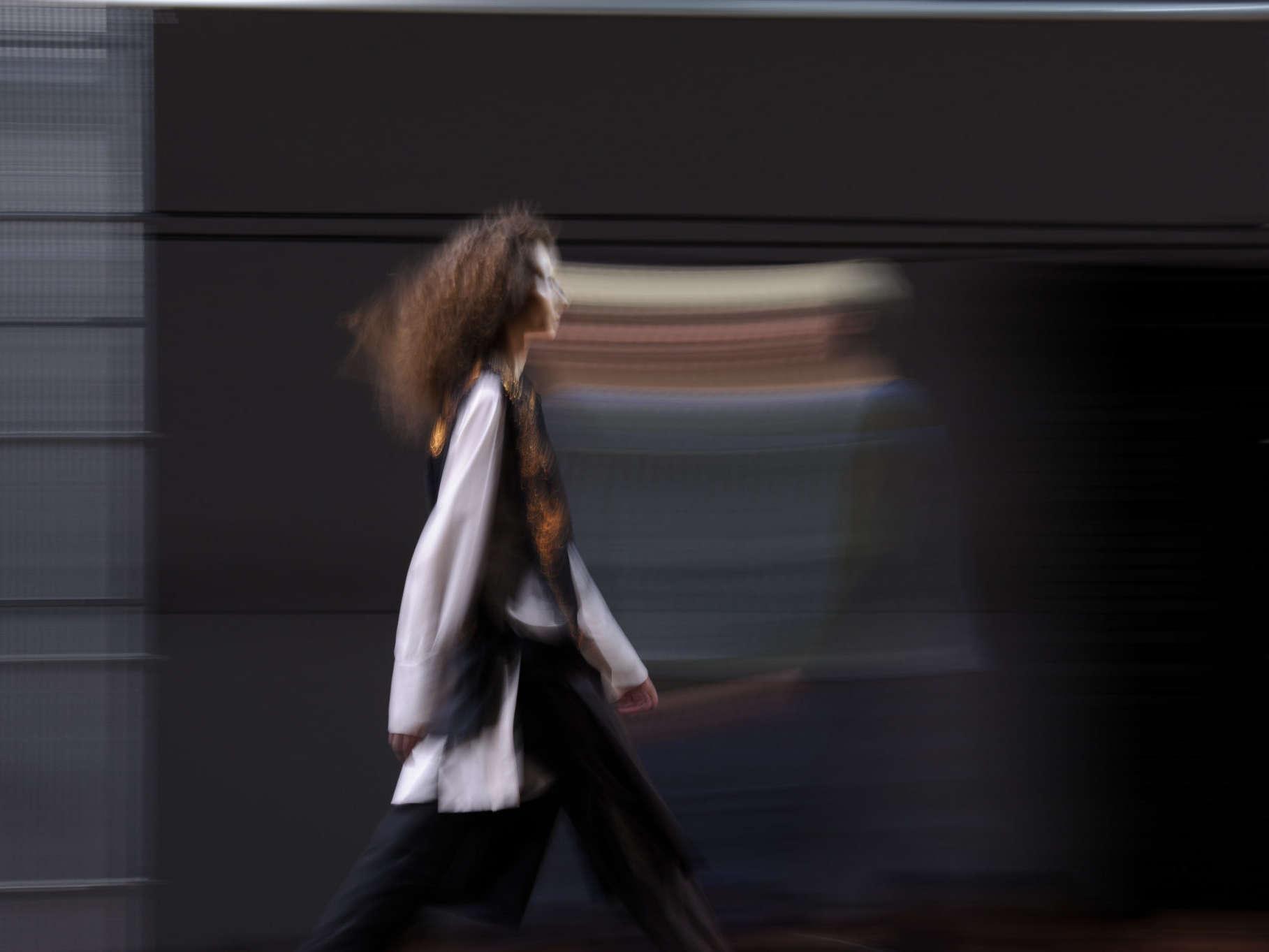 model walking down fashion runway in profile