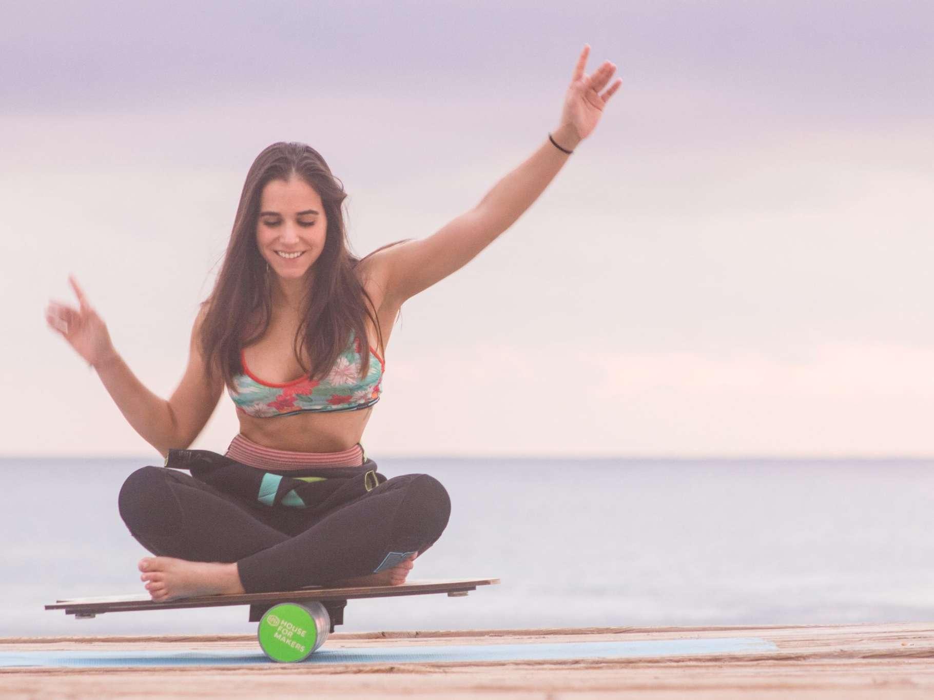 girl balancing on board