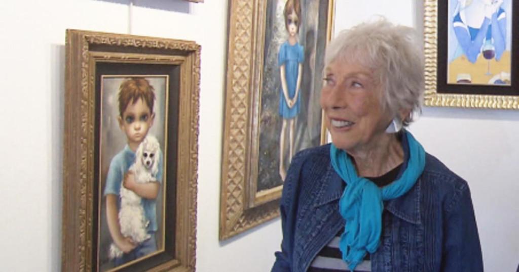 Margaret Keane with her Big Eyes paintings