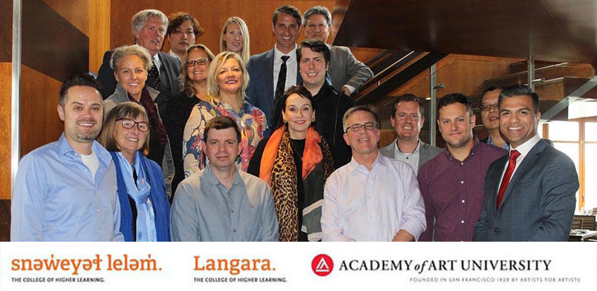 An image of the Academy of Art and Langara Advisory Board standing in a stairwell
