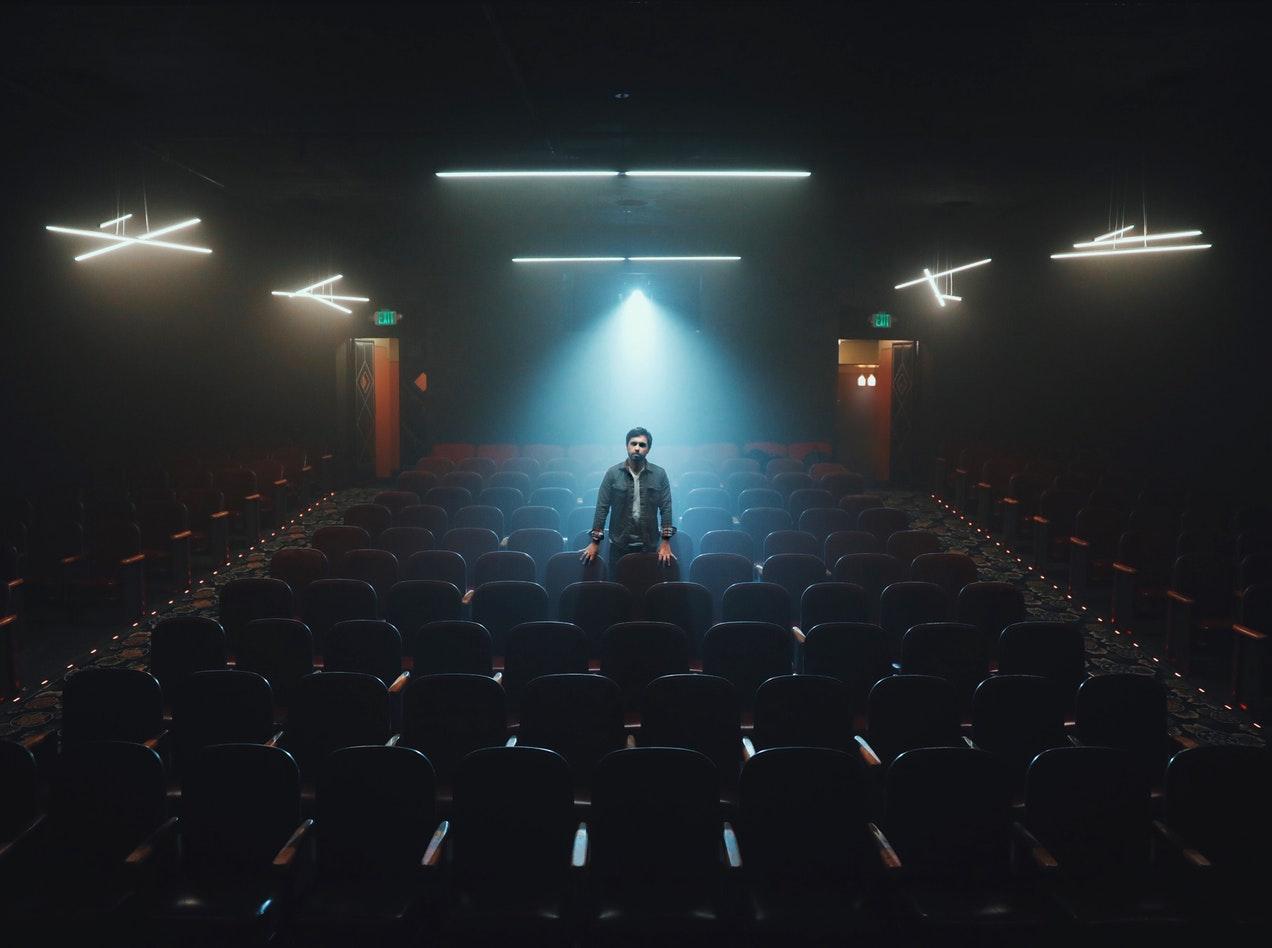 Actor standing in cinema