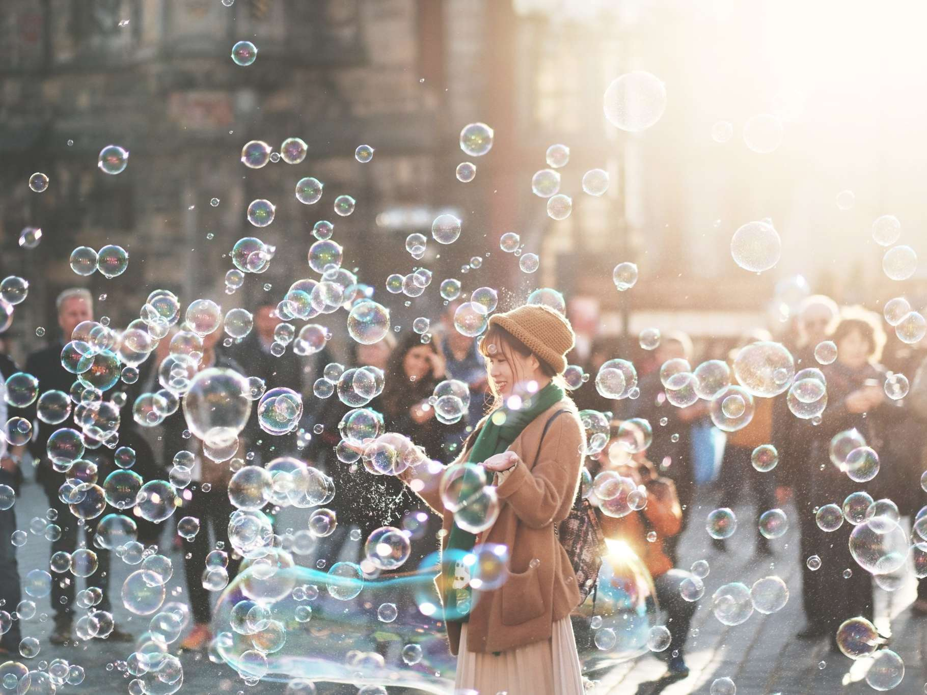 Woman in crowd surrounded by bubbles