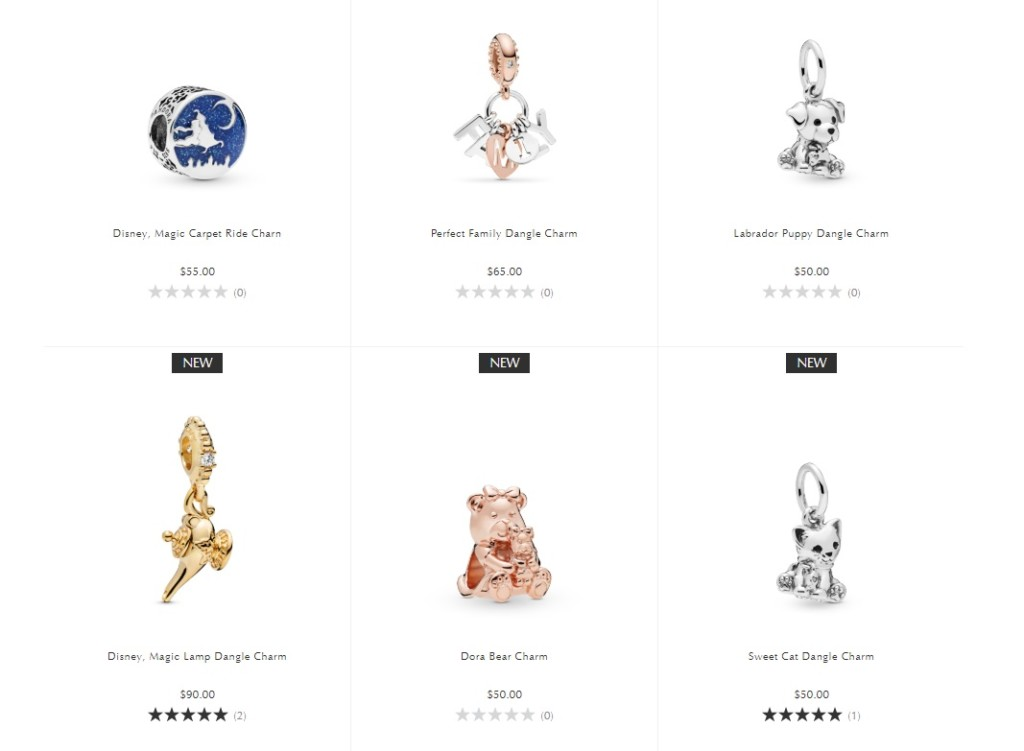"Six charms: a genie's lamp charm, a magic carpet charm, a teddy bear charm, a cat charm, a dog charm, and a charm that reads ""family"""