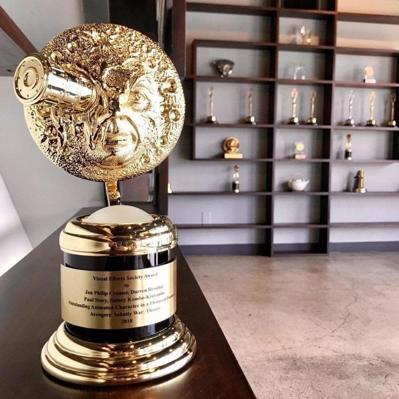 Image of a golden trophy on a desk