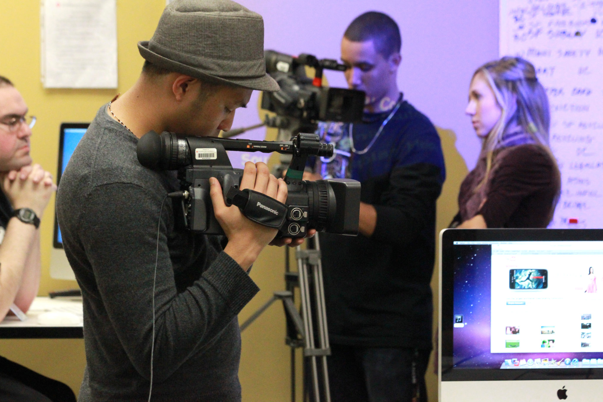Communications student recording with camera