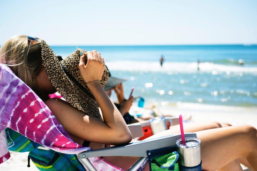 girl enjoying summer at the beach