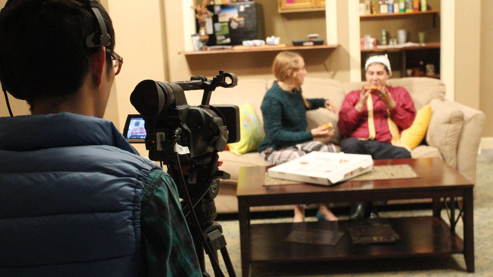 Filming actors on set