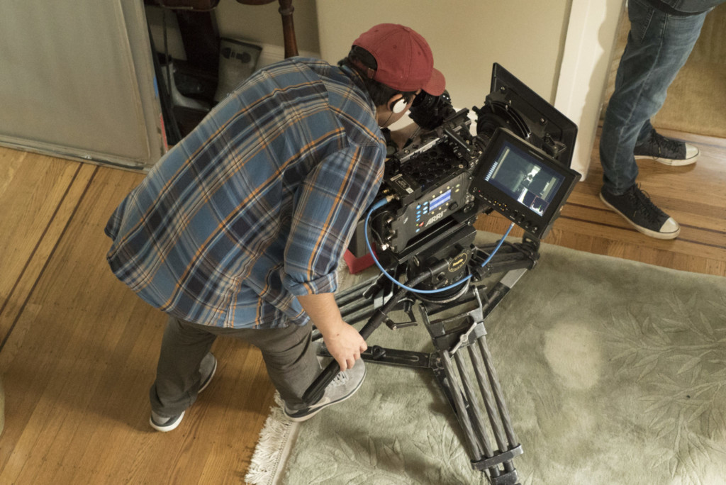 Motion Pictures student behind camera