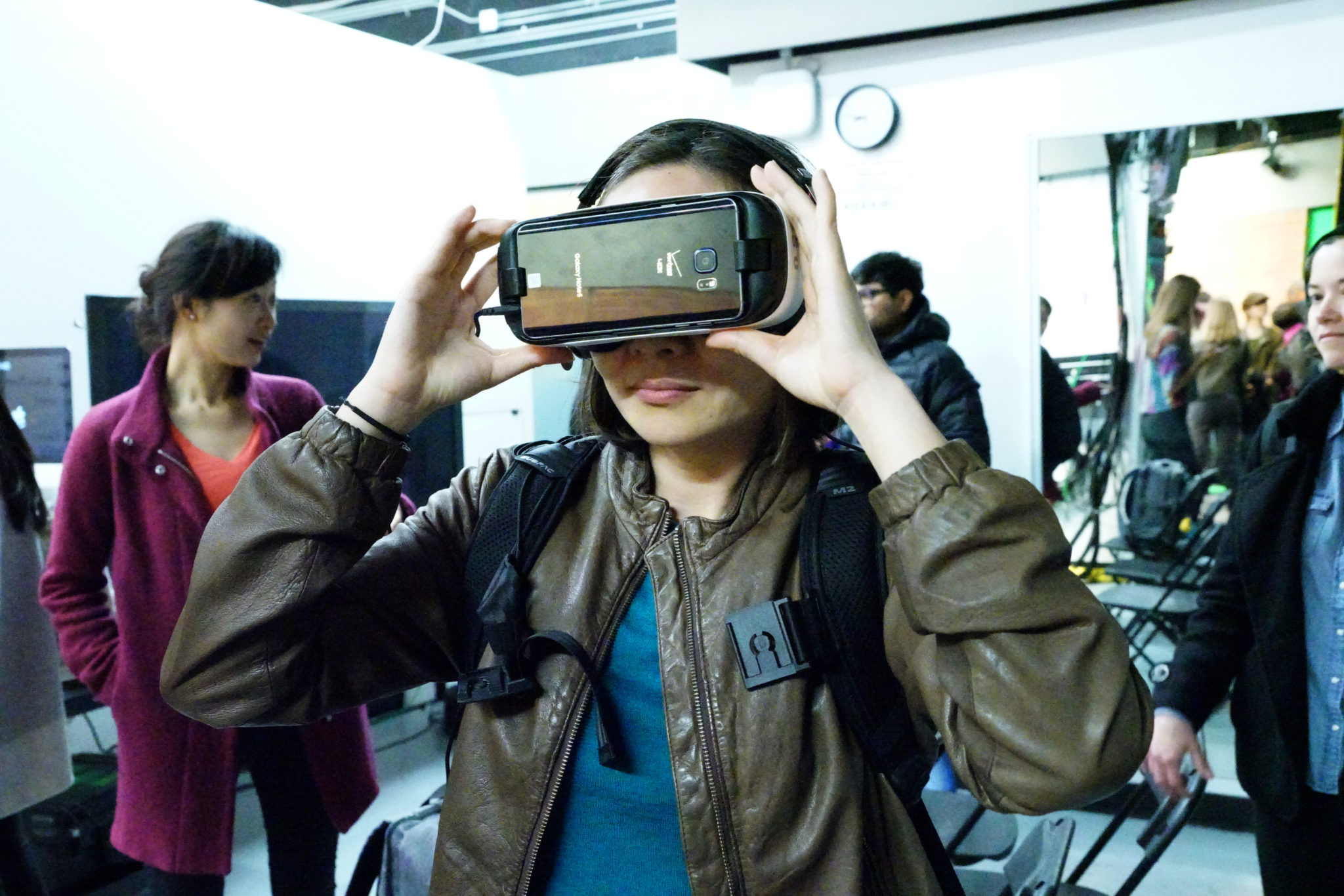 Student wearing virtual reality headset at a campus event