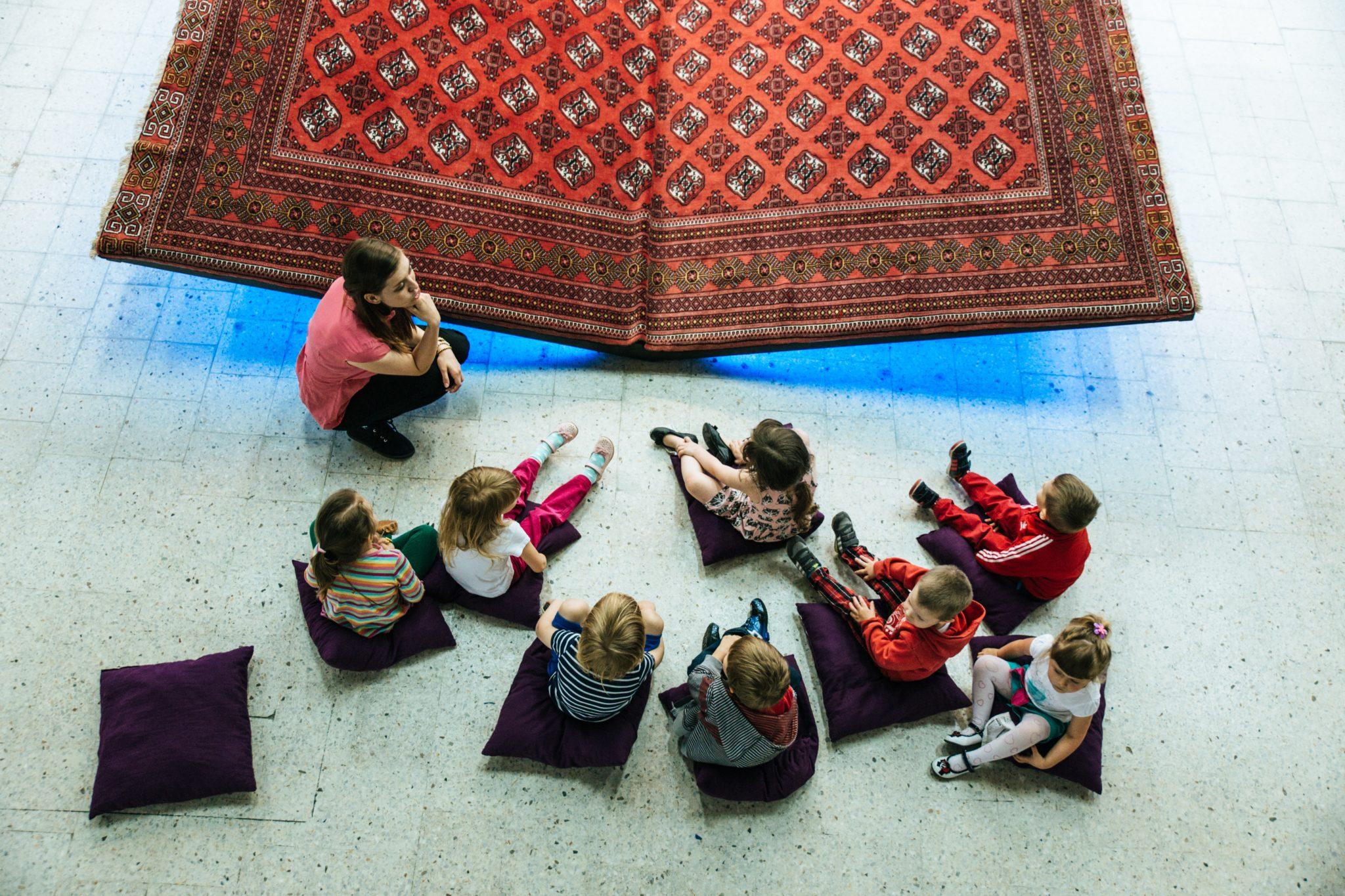 art teacher with kids in museum