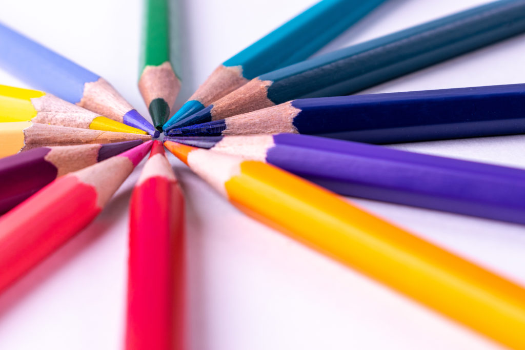 Sharpened colored pencils in a circle touching at the top