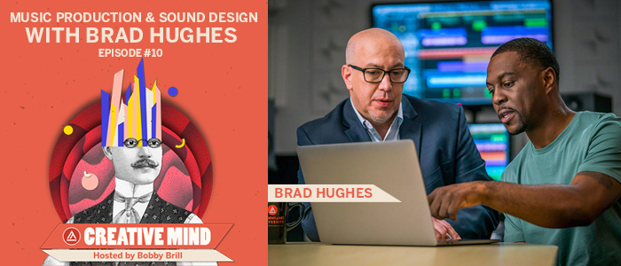 Brad Hughes collaborating with another person, sitting in front of a laptop